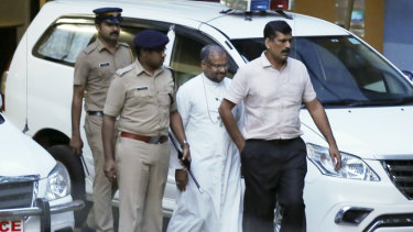Franco Mulakkal, centre, after being questioned by police in Kochi last September. He has now been charged with rape.