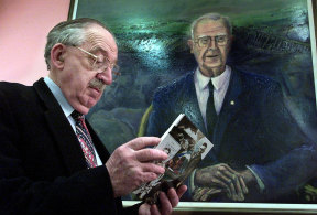 Dr John Duggan with the large portrait  of his colleague Dr Roy Mills at the John Hunter Hospital Library.