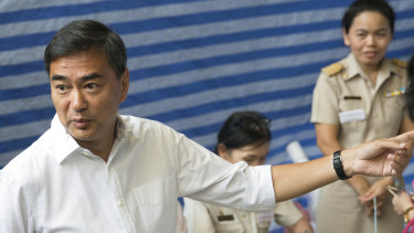 Democrat Party leader Abhisit Vejjajiva gestures as he arrives at a polling station to cast his ballot in Bangkok , Thailand, on Sunday.