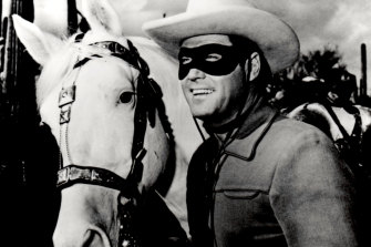 Clayton Moore in his role as The Lone Ranger, crusading against villains on his horse Silver.