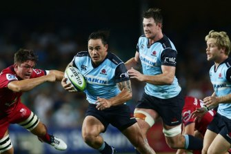 Zac Guildford of the Waratahs makes a break during a Super Rugby match against the Reds at Allianz Stadium in 2016.