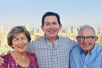 Ian Jacobs (centre) says that after the death of his father, Sidney, it has become increasingly difficult to look after his British-based mother, Shirley, from Australia.