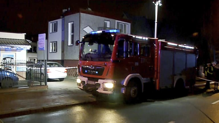 """A fire engine stands outside an """"Escape Room"""" game location in Koszalin, northern Poland."""