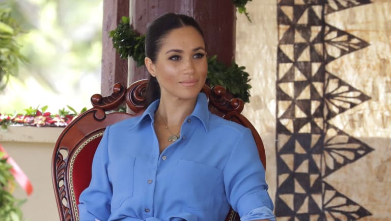 Meghan, Duchess of Sussex smiles during a visit to Tupou College in Tonga.