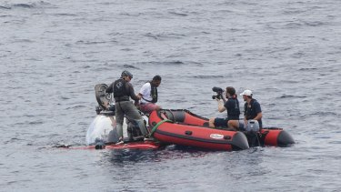 Seychelles President Danny Faure disembarks from a submersible, off the coast of Seychelles on Sunday .