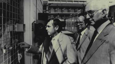 MPs Geoff Muntz, Ken McElligott. and Col Miller talking with prisoners in Boggo Road jail.