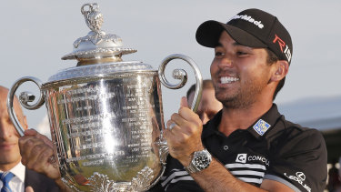 Jason Day lifts the Wanamaker trophy after winning the 2015 PGA Championship.