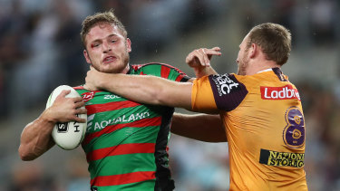 Trading places? George Burgess comes to grips with off-contract Bronco Matt Lodge.