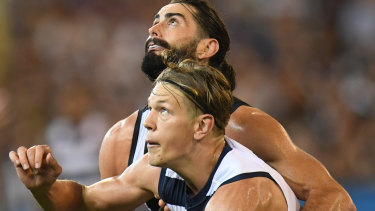 Eyes on prize: Brodie Grundy and Rhys Stanley compete for the ball in round one.