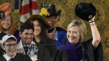 Hillary Clinton holds up a Russian fur hat, an ushanka, with a Soviet era hammer and sickle emblem, to the Yale College class of 2018 during her Class Day address at Yale University