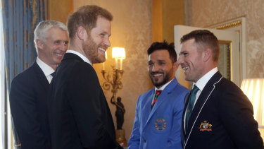 Well bowled: Aaron Finch reacts after a cheeky comment from Prince Harry.