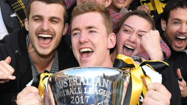 Jacob Townsend (middle) celebrates the 2017 grand final victory.
