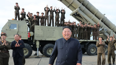 North Korean leader Kim Jong-un smiles at the test-firing of an unspecified missile at an undisclosed location.