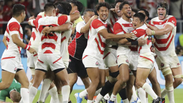 Japan celebrate their shock defeat of Ireland in the World Cup – confirming the host nation's rise in world rugby, though on the basis of scheduling alone, Japan are still a tier-two nation.