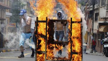 Demonstrators block a street during a protest demanding the resignation of President Juan Orlando Hernandez, in Tegucigalpa, Honduras, on Septermber 15.