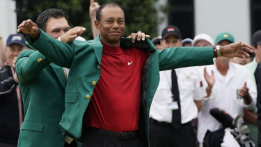 Feels good: Tiger Woods tries on his fifth Masters green jacket for size.