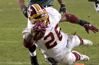 Clinton Portis dives for a touchdown while playing for the Washington Redskins in 2006.