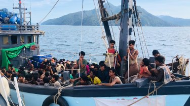 At least two dozen Rohingyan migrants died on the boat and many more boats are believed to remain adrift.