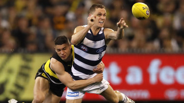 Crunch time: Joel Selwood is tackled by Tiger Dion Prestia during last year's preliminary final against Richmond.