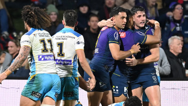 Trent Loiero and the Storm celebrate the try that gave the visitors the half-time lead.