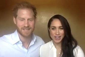 Harry and Meghan address the Queen's Commonwealth Trust by video.