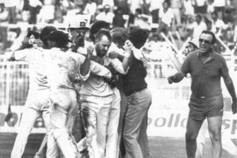 Manager Bobby Simpson, the only person to have participated in two tied Tests runs onto the field to congratulate last-over hero Greg Matthews.