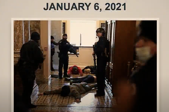 Police point a gun at a rioter in the US Capitol building on January 6.