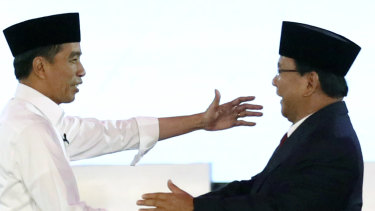 Indonesian President Joko Widodo, left, and his contender Prabowo Subianto shake hands after a televised debate last month.