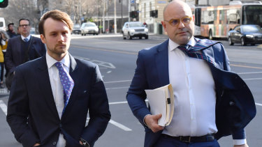 Andrew Nolch and lawyer Glenn Thexton outside the Magistrates Court in August.