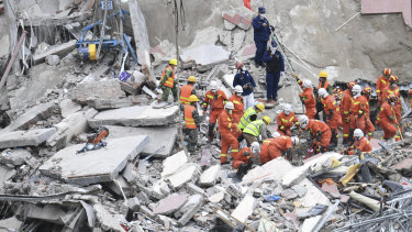 Rescuers search for victims at the site of a hotel collapse in Quanzhou, China, on Sunday.