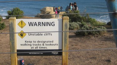 Tourists put their lives at risk by ignoring warning signs on unstable cliffs at the world-acclaimed Twelve Apostles coastal icon.