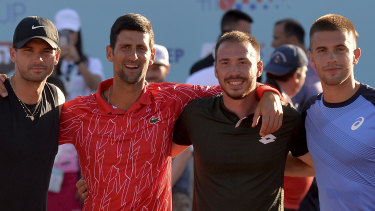 Novak Djokovic poses with Bulgaria's Grigor Dimitrov (left), Serbia's Viktor Troicki and Croatia's Borna Coric in Croatia. All have tested positive to COVID-19.