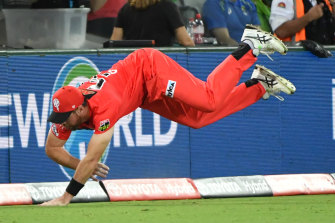 Daniel Christian saves a boundary with a determined effort.