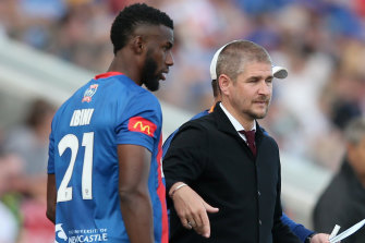 Bernie Ibini and then-Jets coach Carl Robinson, who he is set to follow to the Western Sydney Wanderers.