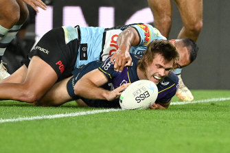 Ryan Papenhuyzen crosses for one of his three tries against Cronulla on Friday night.
