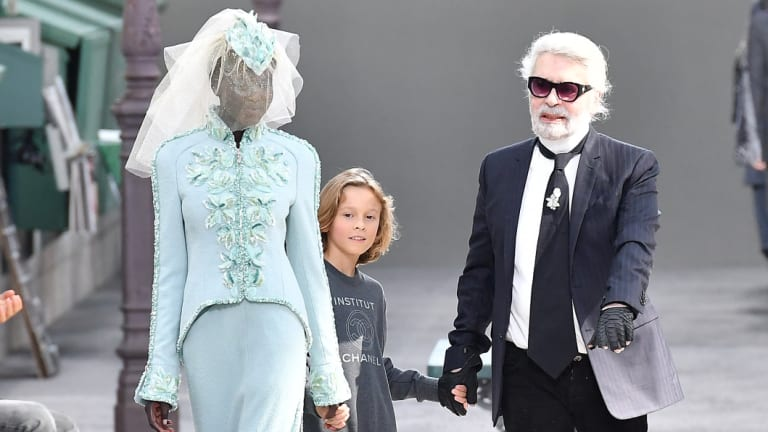 Adut Akech Bior closing the Chanel haute couture show with designer Karl Lagerfeld and his godson Hudson Kroenig in Paris on July 3. She is only the second black model to do so.
