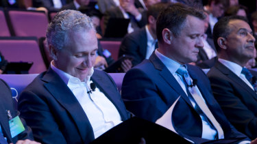 Telstra chief executive Andy Penn (left) and Michael Ackland (right) at Telstra's 5G announcement in Sydney in December.