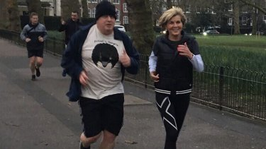 Julie Bishop and Boris Johnson enjoy a brisk jog around London.