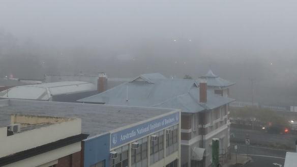 Fog blankets south-east Queensland after overnight rain