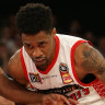 Bryce Cotton of Perth (right) contests with Casper Ware of Melbourne during the Round 18 NBL match between Melbourne United and the Perth Wildcats at Melbourne Arena in Melbourne, Sunday, February 17, 2019.