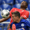 Schalke's Bastian Oczipka (front) competes with Augsburg's Felix Uduokhai during the Miners' 3-0 Bundesliga loss on Sunday.