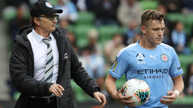Melbourne City coach Erick Mombaerts speaks to Scott Galloway on the sidelines during the round two match between against Adelaide United at AAMI Park.