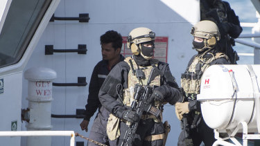Armed forces aboard the Turkish oil tanker El Hiblue 1, which was hijacked by migrants.