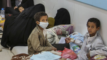 Patients suffering from severe diarrhoea and suspected of cholera, wait to receive treatment, at a hospital in Sanaa.