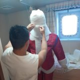 One crew member of the Anastasia consoling himself with a  Santa he made from material found onboard.