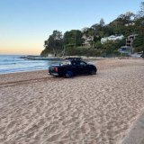 A driver with the licence plate number MR GOLD got into a spot of bother outside Laurie Sutton's beachfront property.