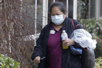 A masked worker at the Life Care Centre in Kirkland, Washington, where several residents of the facility have died as a result of the COVID-19 disease.