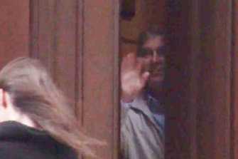 Prince Andrew appears to wave goodbye to a woman in the video.