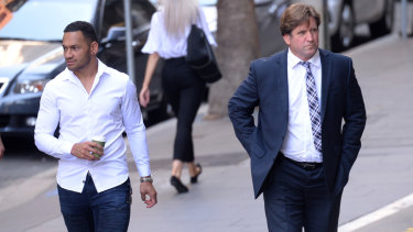 Manly coach Des Hasler arrives at court with Api Koroisau on Tuesday.