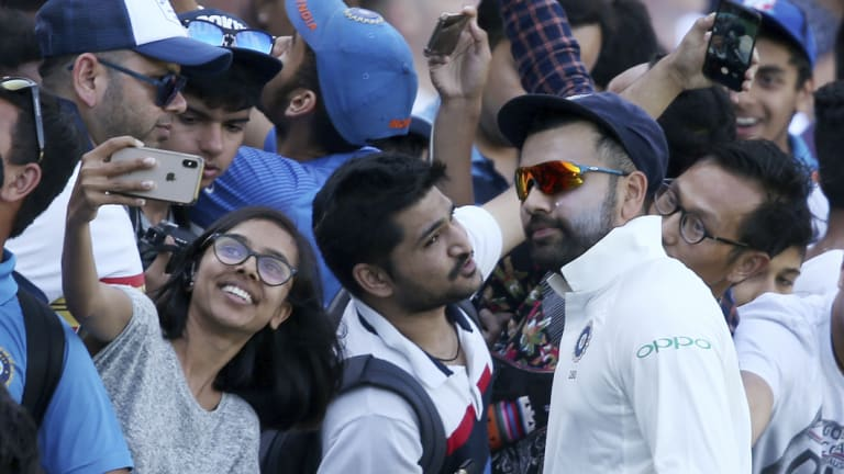 Rohit Sharma meets fans during a break in India's tour match in Sydney last month.
